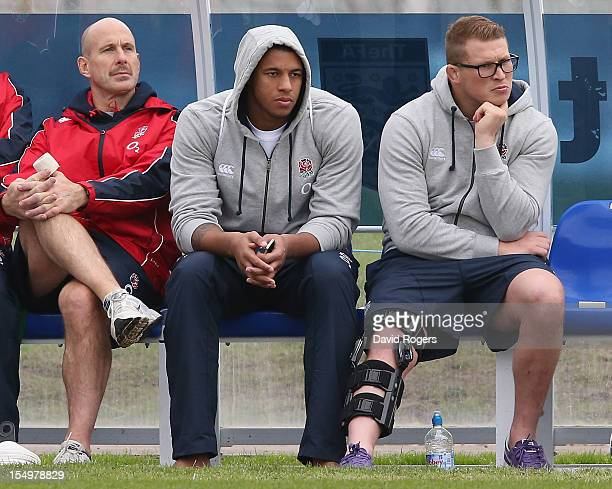 Dylan Hartley and Courtney Lawes sit out training with England physio Phil Pask during the England training session held at St Georges Park on...