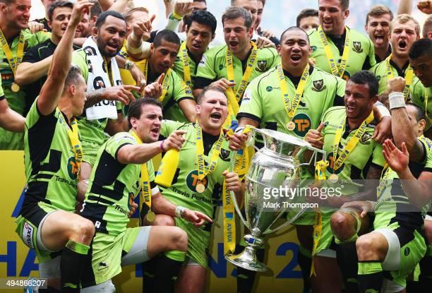 Dylan Hartley and his Northampton Saints team mates celebrate after winning the Aviva Premiership Final between Saracens and Northampton Saints at...