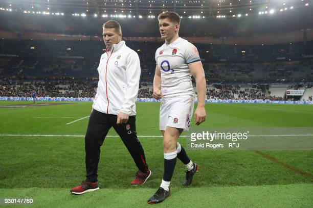 Dylan Hartley and Owen Farrell of England look dejected after the NatWest Six Nations match between France and England at Stade de France on March...