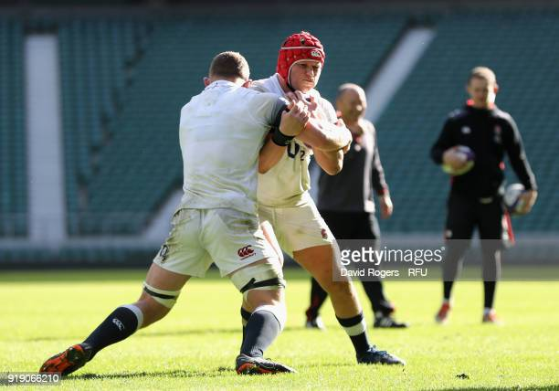 Dylan Hartley is tackled by Sam Underhill during the England training session held at Twickenham Stadium on February 16 2018 in Twickenham England