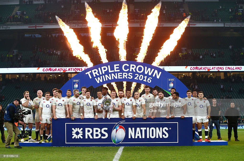 Dylan Hartley of England celebrates with team mates and the Triple Crown trophy after the RBS Six Nations match between England and Wales at Twickenham Stadium on March 12, 2016 in London, England.