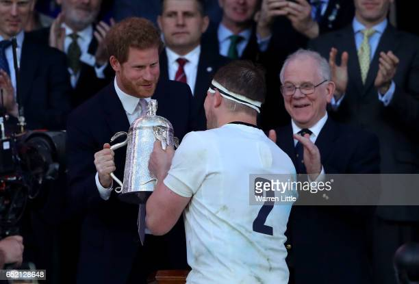 Dylan Hartley of England collects the The Calcutta cup from Prince Harry during the RBS Six Nations match between England and Scotland at Twickenham...
