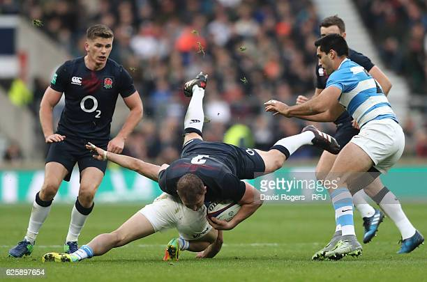 Dylan Hartley of England is upended in the tackle during the Old Mutual Wealth Series match between England and Argentina at Twickenham Stadium on...