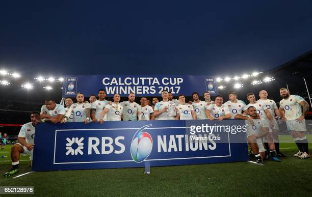 Dylan Hartley of England lifts the The Calcutta cup with his England team mates after the RBS Six Nations match between England and Scotland at...