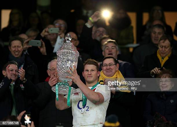 Dylan Hartley of England lifts the trophy after the final whistle during the Old Mutual Wealth Series match between England and Australia at...