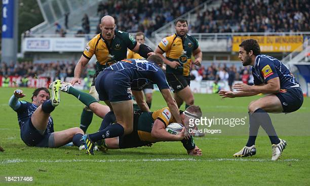 Dylan Hartley of Northampton dives over for a try during the Heineken Cup match between Castres and Northampton Saints at Stade Pierre Antoine on...