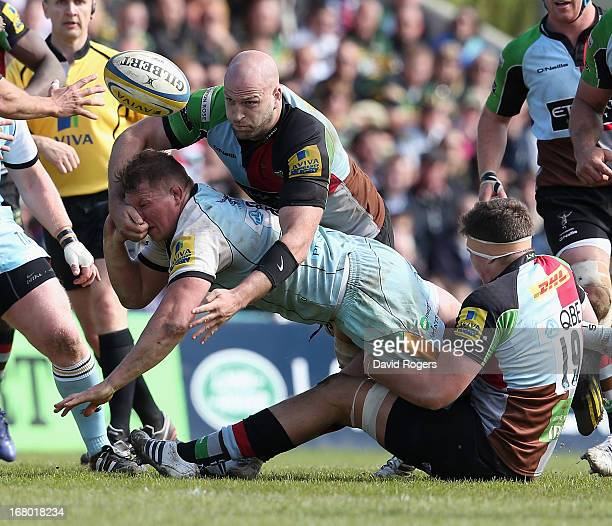 Dylan Hartley of Northampton is tackled by George Robson and Charlie matthews during the Aviva Premiership match between Harlequins and Northampton...