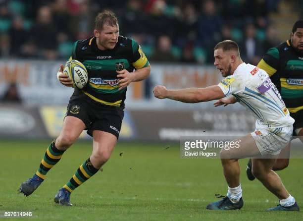 Dylan Hartley of Northampton moves past Sam Hill during the Aviva Premiership match between Northampton Saints and Exeter Chiefs at Franklin's...