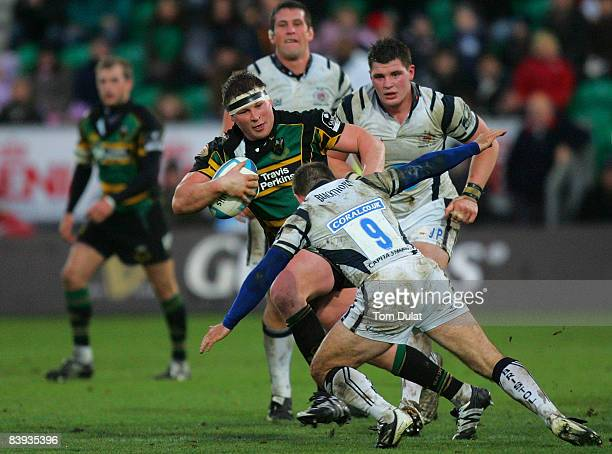 Dylan Hartley of Northampton Saints is challenged by Graeme Beveridge of Bristol Rugby during the European Challenge Cup match between Northampton...
