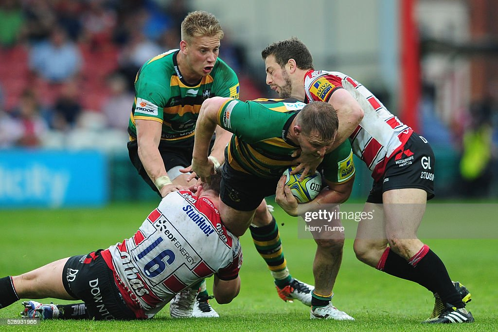Dylan Hartley of Northampton Saints is tackled by Greig Laidlaw of Gloucester Rugby during the Aviva Premiership match between Gloucester Rugby and Northampton Saints at Kingsholm on May 07, 2016 in Gloucester, England.