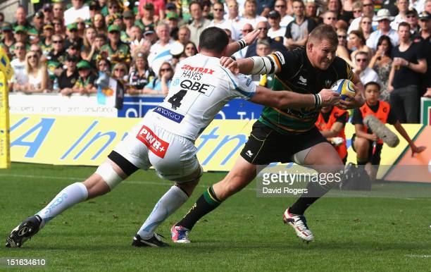 Dylan Hartley the Northampton captain breaks clear of Tom Hayes to score a try during the Aviva Premiership match between Northampton Saints and...