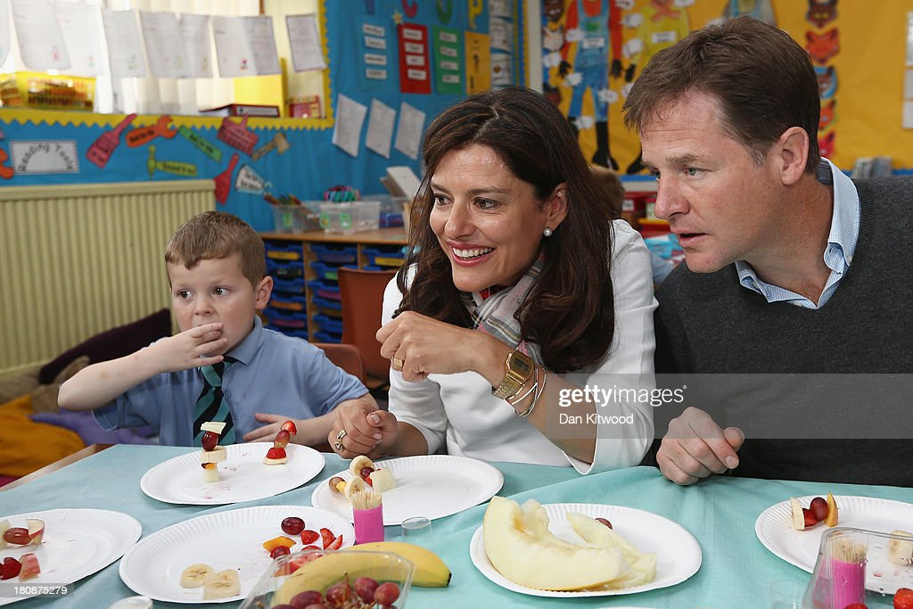 Dylan Hogg, 6, (L), Liberal Demcrat leader Nick Clegg and his wife Miriam Gonzalez Durantez take part in a 'Healthy Eating' class at Lairdsland Primary School on September 17, 2013 in Glasgow, Scotland. Danny Alexander, Chief Secretary to the Treasury will give his key-note speech today when he will focus on the economy. Today is day four of the Liberal Democrat Autumn conference.