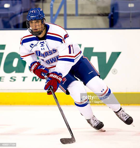 Dylan Hollman of the Massachusetts Lowell River Hawks skates against the St. Thomas University Tommies during NCAA exhibition hockey at the Tsongas...
