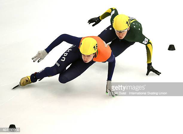 Dylan Hoogerwerf of Netherlands and Hyun Woo Jung of Australia compete in Men's 500m race during day two of the ISU World Junior Short Track Speed...