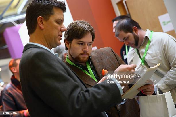 Dylan Horne of Jackson Mississippi talks with Ralph Morgan COO of OPenVAPE and Organa Labs at CannaSearch Colorado's first cannabis job fair on March...