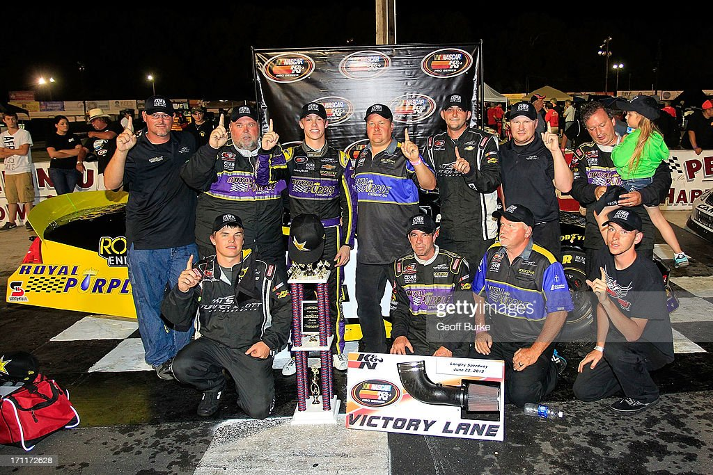 Dylan Kwasniewski, driver of the #98 Royal Purple/Rockstar Energy Drink Chevrolet, celebrates with his team in victory lane after winning the NASCAR K&N Pro Series East Visit Hampton VA 175 at Langley Speedway on June 22, 2013 in Langley, Virginia.