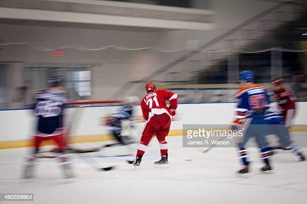 Dylan Larkin of the Detroit Red Wings skates towards goal during a photo shoot at the 2015 NHLPA Rookie Showcase at Mattamy Athletic Centre on...