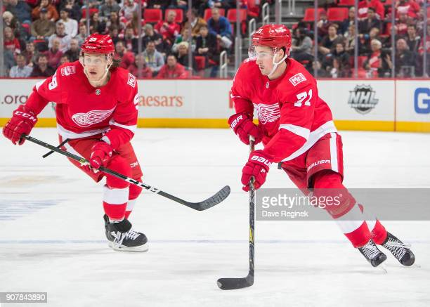 Dylan Larkin and Tyler Bertuzzi of the Detroit Red Wings skates up ice with the puck against the Dallas Stars during an NHL game at Little Caesars...