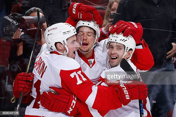 Dylan Larkin Danny DeKeyser and Pavel Datsyuk of the Detroit Red Wings celebrate after DeKeyser scored the game winning overtime goal against the...