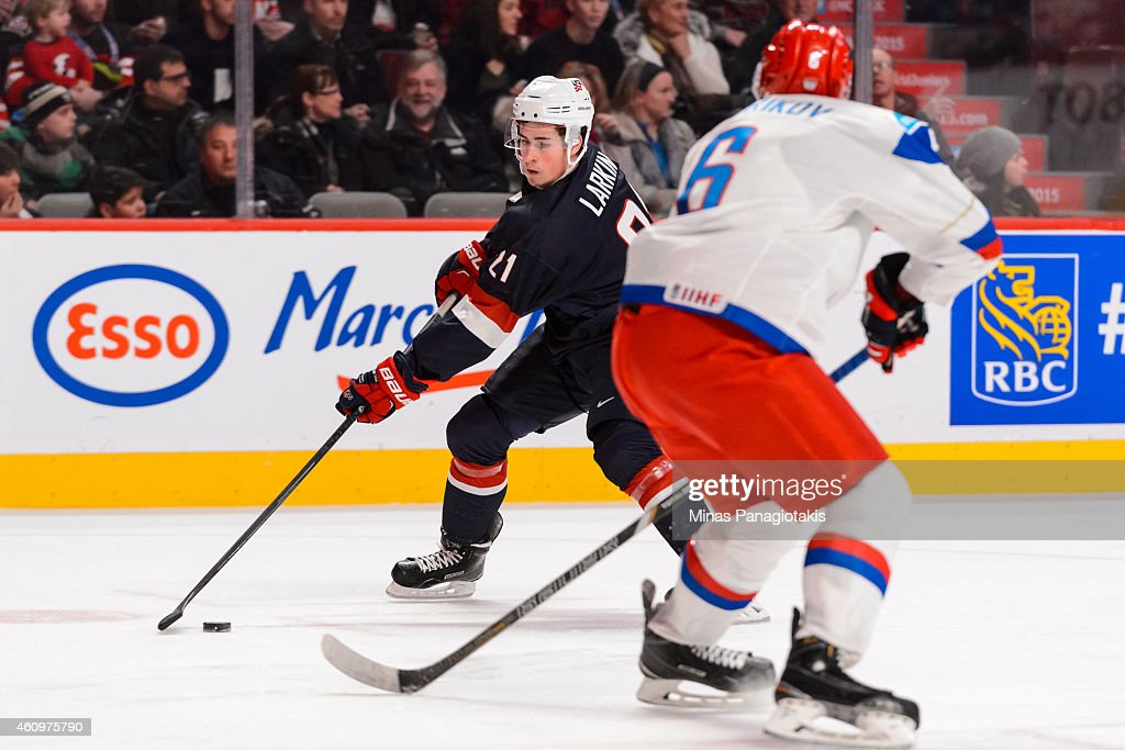 Dylan Larkin #21 of Team United States carries the puck in a quarterfinal round during the 2015 IIHF World Junior Hockey Championships against Team Russia at the Bell Centre on January 2, 2015 in Montreal, Quebec, Canada.