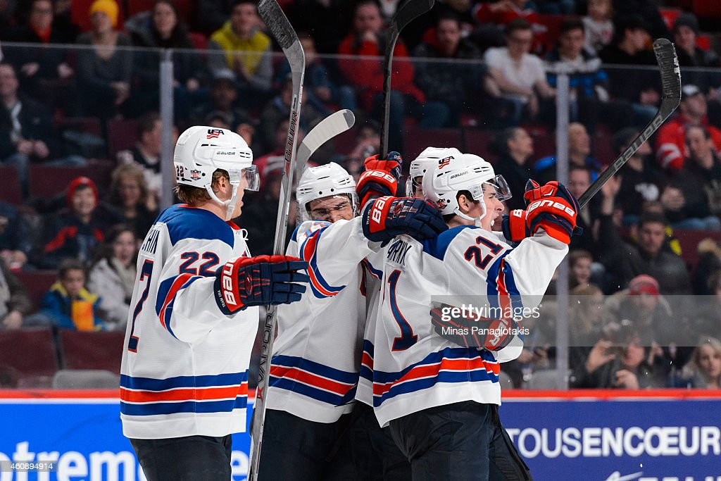 Dylan Larkin #21 of Team United States celebrates his goal with teammates during the 2015 IIHF World Junior Hockey Championship game against Team Slovakia at the Bell Centre on December 29, 2014 in Montreal, Quebec, Canada. Team United States defeated Team Slovakia 3-0.