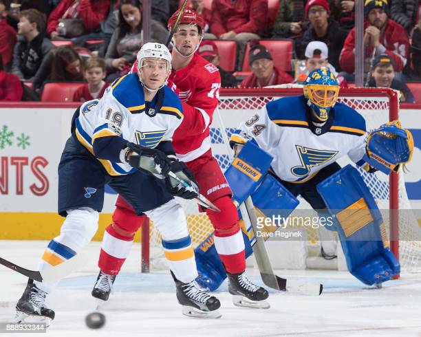 Dylan Larkin of the Detroit Red Wings battles for position with Jay Bouwmeester of the St Louis Blues in front of goaltender Jake Allen of the Blues...