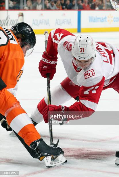 Dylan Larkin of the Detroit Red Wings battles for the puck on a faceoff against Nolan Patrick of the Philadelphia Flyers on December 20 2017 at the...