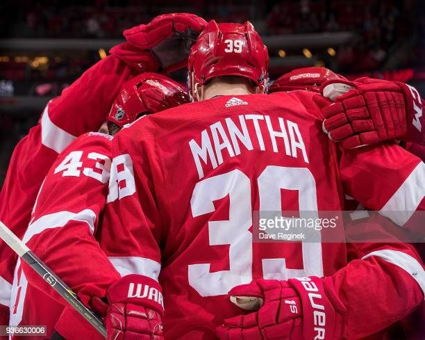 Dylan Larkin of the Detroit Red Wings celebrates a third period goal with teammates Anthony Mantha and Darren Helm during an NHL game against the...