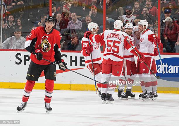 Dylan Larkin of the Detroit Red Wings celebrates his first period goal with teammates Mike Green Niklas Kronwall Gustav Nyquist and Justin Abdelkader...