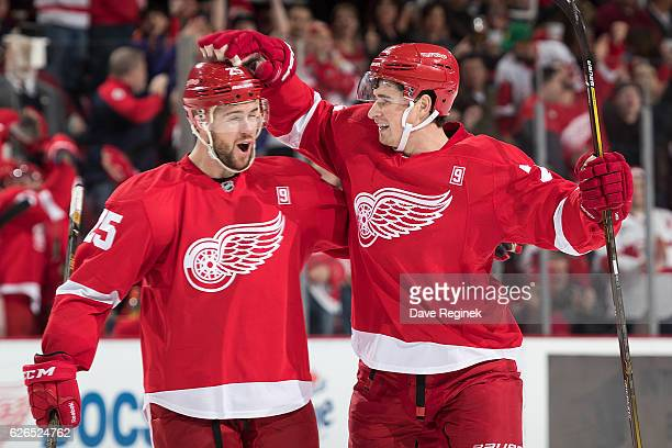 Dylan Larkin of the Detroit Red Wings celebrates his first period goal with teammate Mike Green during an NHL game against the Dallas Stars at Joe...