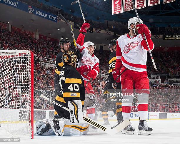 Dylan Larkin of the Detroit Red Wings celebrates his first period goal with teammate Riley Sheahan in front of Tuukka Rask Dominic Moore and Frank...