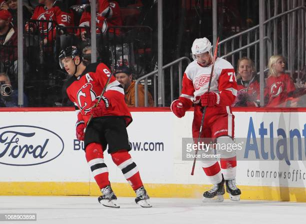 Dylan Larkin of the Detroit Red Wings celebrates his game winning goal against the New Jersey Devils at 409 of overtime as Taylor Hall looks on at...