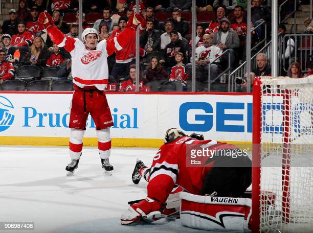 Dylan Larkin of the Detroit Red Wings celebrates his goal in the third period as Cory Schneider of the New Jersey Devils defends on January 22 2018...