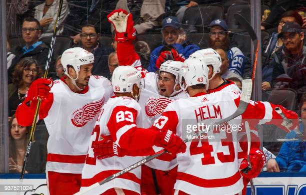 Dylan Larkin of the Detroit Red Wings celebrates his goal on the Toronto Maple Leafs with teammates Jonathan Ericsson Trevor Daley Darren Helm and...