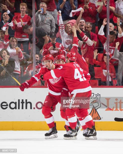 Dylan Larkin of the Detroit Red Wings celebrates his second period goal with teammates Martin Frk and Anthony Mantha during the first ever NHL game...
