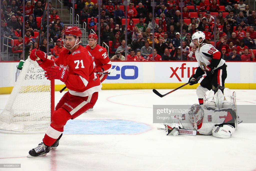 Dylan Larkin #71 of the Detroit Red Wings celebrates his second period goal in front of Mike Condon #1 of the Ottawa Senators at Little Caesars Arena on March 31, 2018 in Detroit, Michigan.