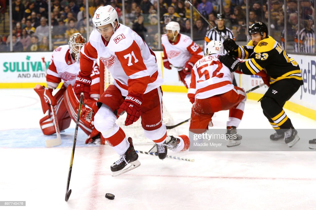 Dylan Larkin #71 of the Detroit Red Wings clears the puck during the third period against the Boston Bruins at TD Garden on December 23, 2017 in Boston, Massachusetts. The Bruins defeat the Red Wings 3-1.