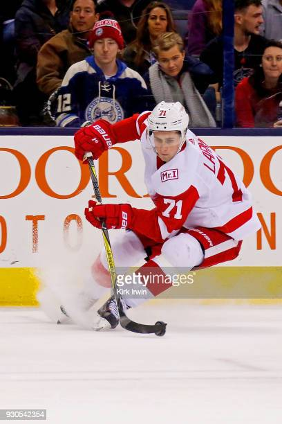 Dylan Larkin of the Detroit Red Wings controls the puck during the game against the Columbus Blue Jackets on March 9 2018 at Nationwide Arena in...
