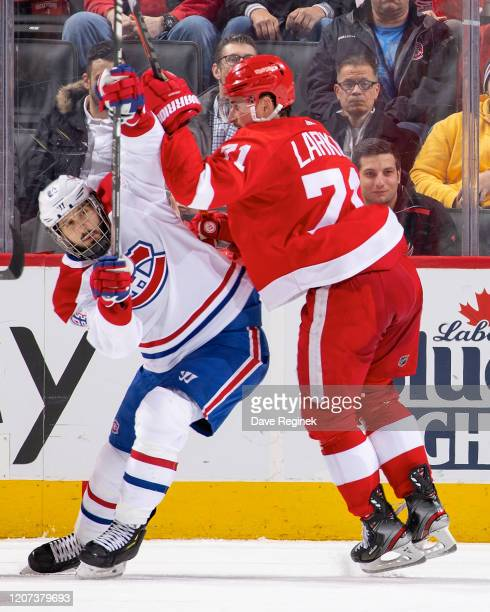 Dylan Larkin of the Detroit Red Wings defends against Phillip Danault of the Montreal Canadiens during an NHL game at Little Caesars Arena on...