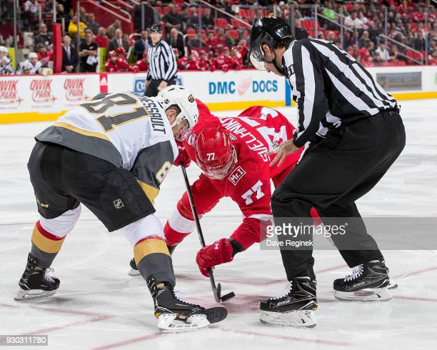 Dylan Larkin of the Detroit Red Wings faces off against Jonathan Marchessault of the Vegas Golden Knights during an NHL game at Little Caesars Arena...