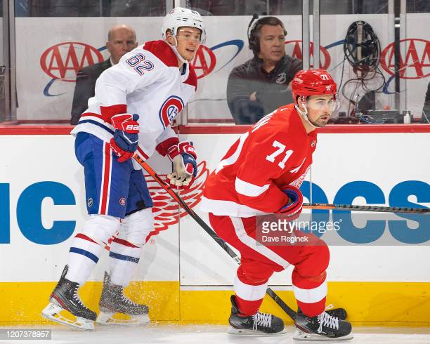 Dylan Larkin of the Detroit Red Wings follows the play in front of Artturi Lehkonen of the Montreal Canadiens during an NHL game at Little Caesars...