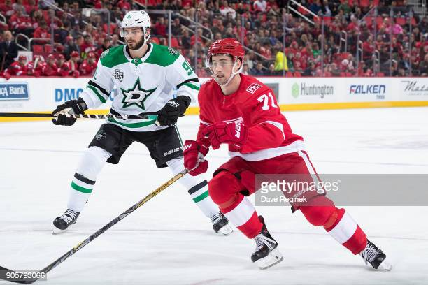 Dylan Larkin of the Detroit Red Wings follows the play in front of Tyler Seguin of the Dallas Stars during an NHL game at Little Caesars Arena on...