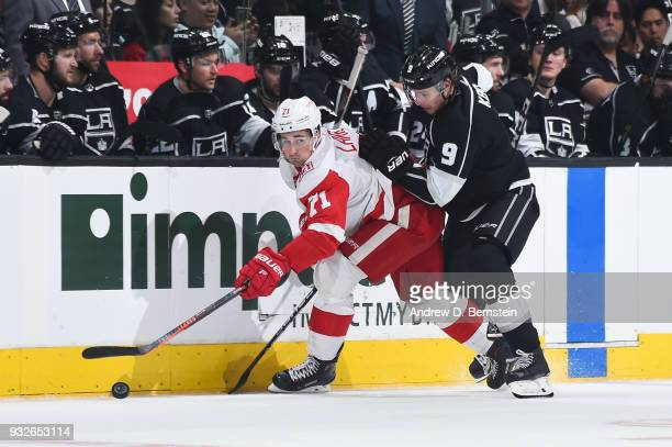 Dylan Larkin of the Detroit Red Wings handles the puck against Adrian Kempe of the Los Angeles Kings at STAPLES Center on March 15 2018 in Los...