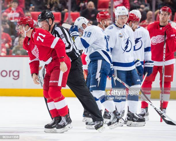 Dylan Larkin of the Detroit Red Wings heads to the lockeroom for repairs after a fight during an NHL game against the Tampa Bay Lightning at Little...