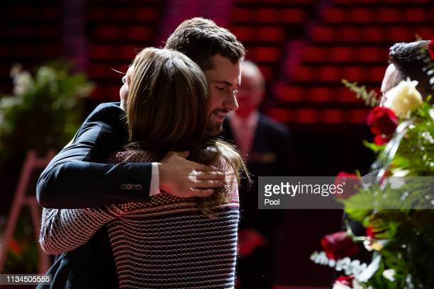 Dylan Larkin of the Detroit Red Wings hugs Ted's grand daughter Candice Berman during the public visitation of NHL Hall of Famer and former Detroit...
