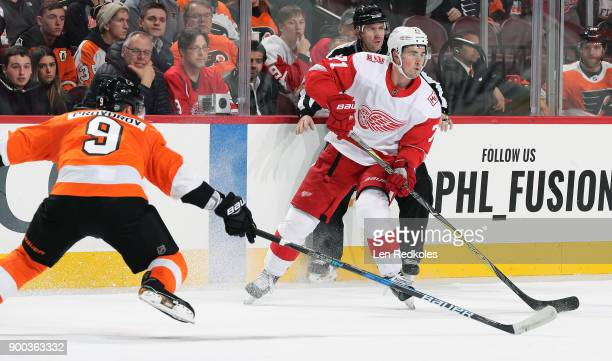 Dylan Larkin of the Detroit Red Wings in action against Ivan Provorov of the Philadelphia Flyers on December 20 2017 at the Wells Fargo Center in...