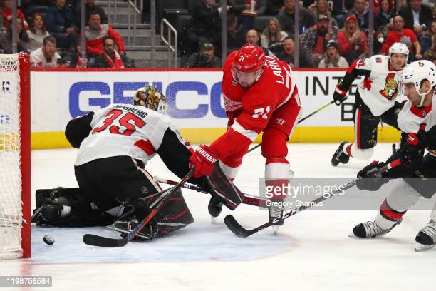 Dylan Larkin of the Detroit Red Wings scores a second period goal past Marcus Hogberg of the Ottawa Senators at Little Caesars Arena on January 10...