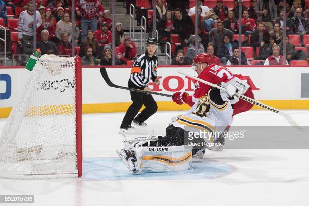 Dylan Larkin of the Detroit Red Wings scores a third period goal on Tuukka Rask of the Boston Bruins during an NHL game at Little Caesars Arena on...