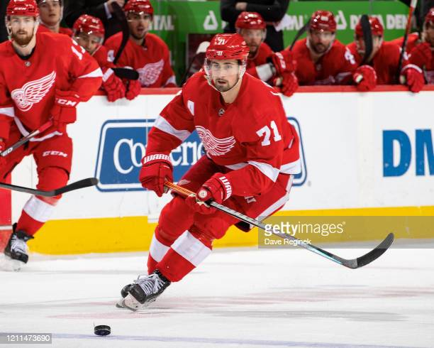 Dylan Larkin of the Detroit Red Wings skates after a loose puck against the Tampa Bay Lightning during an NHL game at Little Caesars Arena on March...