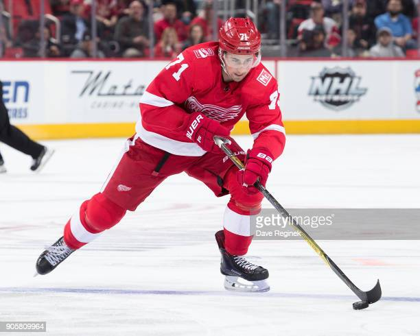 Dylan Larkin of the Detroit Red Wings skates with the puck up ice during an NHL game against the Dallas Stars at Little Caesars Arena on January 16...